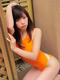 Sexy gravure idol chick shows her curves in a tight swim suit