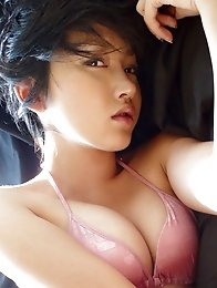 Sexy gravure idol beauty seduces painfully in her pink lingerie